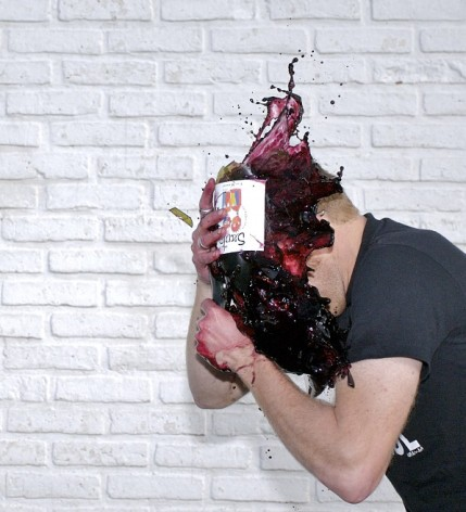 Wine smashed against head